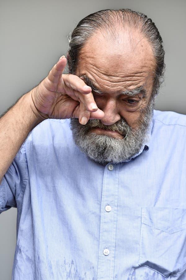 Tearful Old Male Grandfather. A hispanic senior adult male stock photos