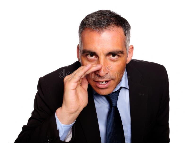 Hispanic Senior Executive Telling A Confidence Royalty Free Stock Image
