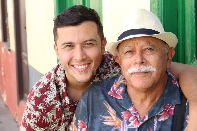 Hispanic senior man with his son royalty free stock photography