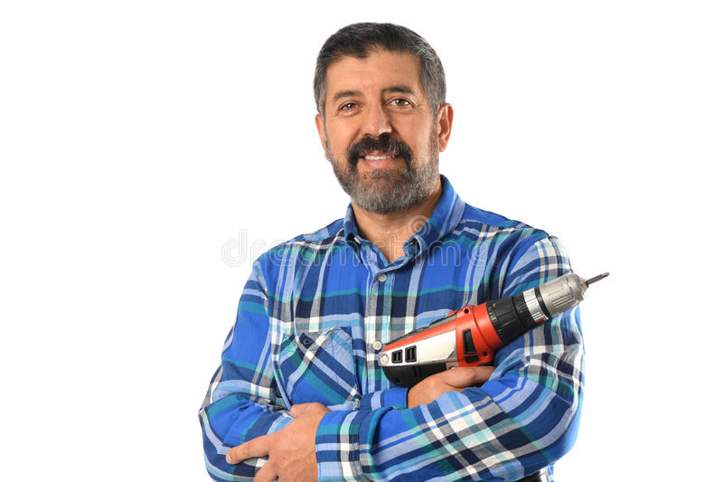 Senior Man Holding Drill. Hispanic senior man holding electrical drill isolated over white background stock photography