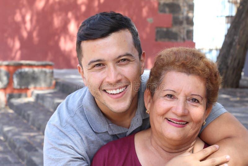 Hispanic senior woman with her son royalty free stock image