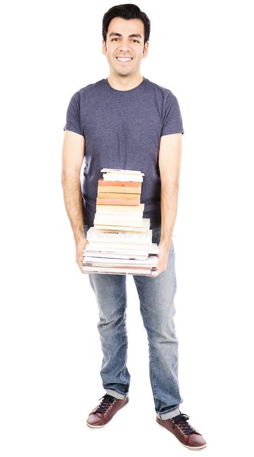 Hispanic student carrying books royalty free stock photography