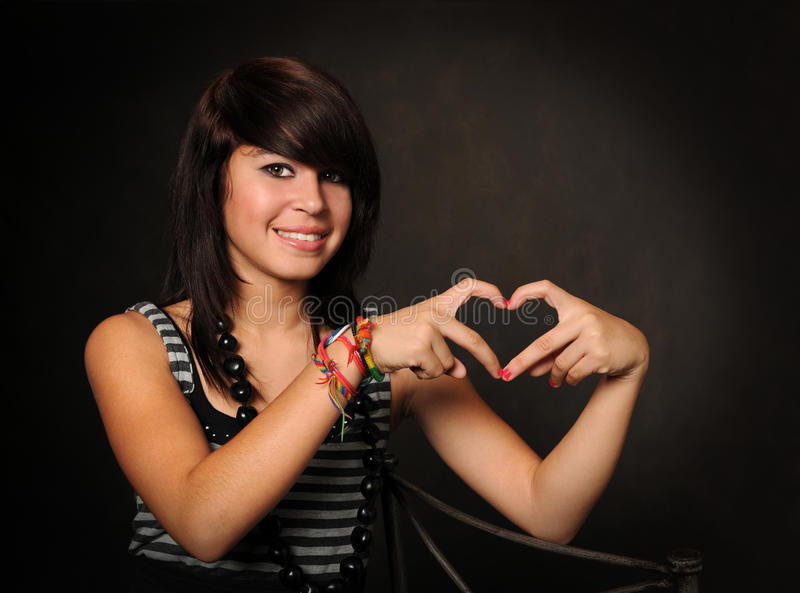 Download Hispanic Teen Forming Heart Stock Image - Image: 15595679