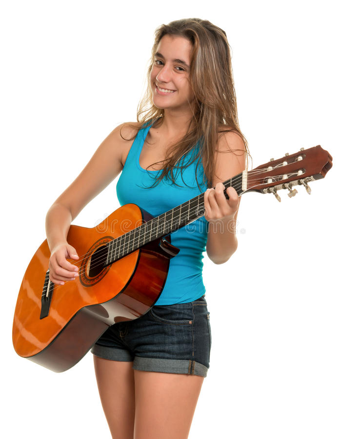 Hispanic teenage girl playing an acoustic guitar. Isolated on a white background stock photo