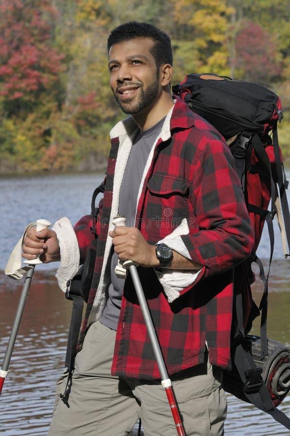 Hispanic Traveler with Trekking Poles royalty free stock photography