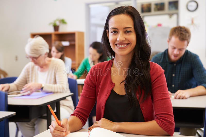Hispanic woman at an adult education class looking to camera. Hispanic women at an adult education class looking to camera stock photography