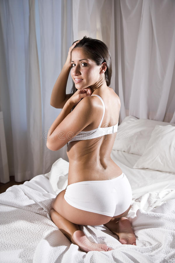 Download Hispanic Woman In Bed Wearing Underwear Stock Image - Image: 16297401