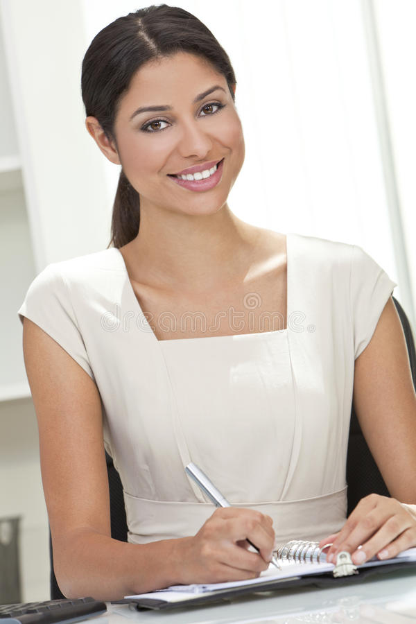 Hispanic Woman Businesswoman Writing In Office Royalty Free Stock Photos