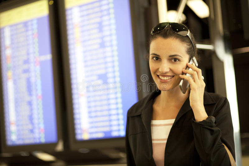 Hispanic woman calling at airport royalty free stock photos