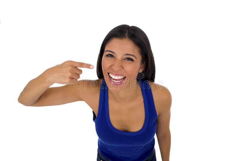 Hispanic woman in casual top and jeans smiling happy and cheerful pointing mouth and teeth. Young attractive hispanic woman in casual top and jeans smiling happy stock image