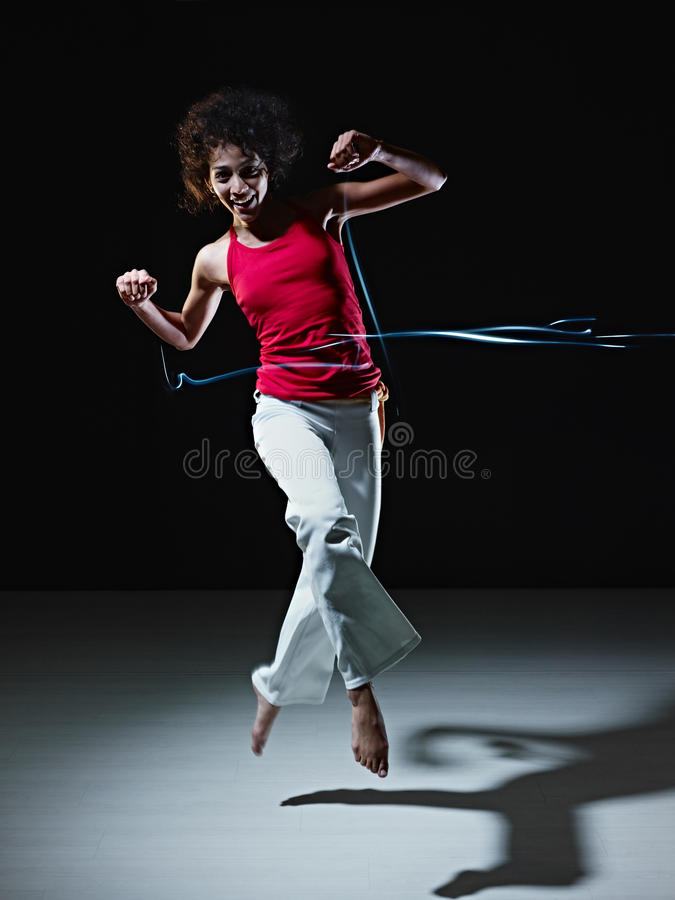 Download Hispanic Woman Dancing And Jumping With Lights Stock Photo - Image: 18492472