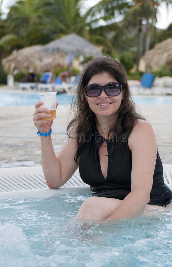 Hispanic Woman Drinking Beer In A Resort Royalty Free Stock Photo
