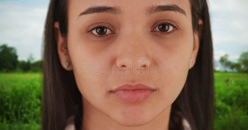 Hispanic woman looking at camera stock photo