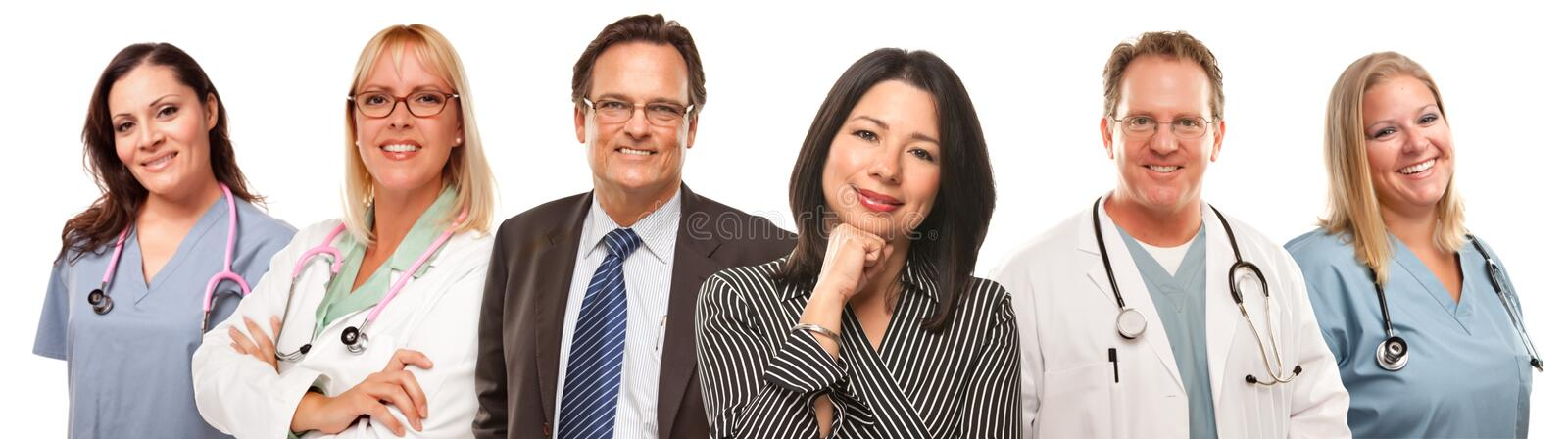 Hispanic Woman and Man with Doctors or Nurses royalty free stock photography