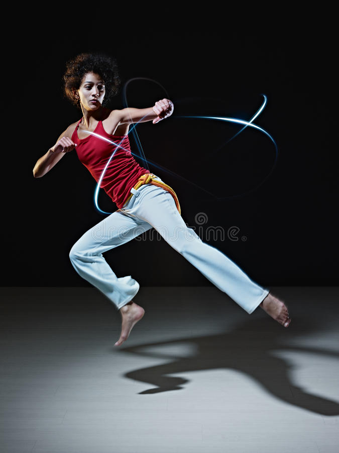 Download Hispanic Woman Playing Capoeira Martial Art Stock Image - Image: 18522811