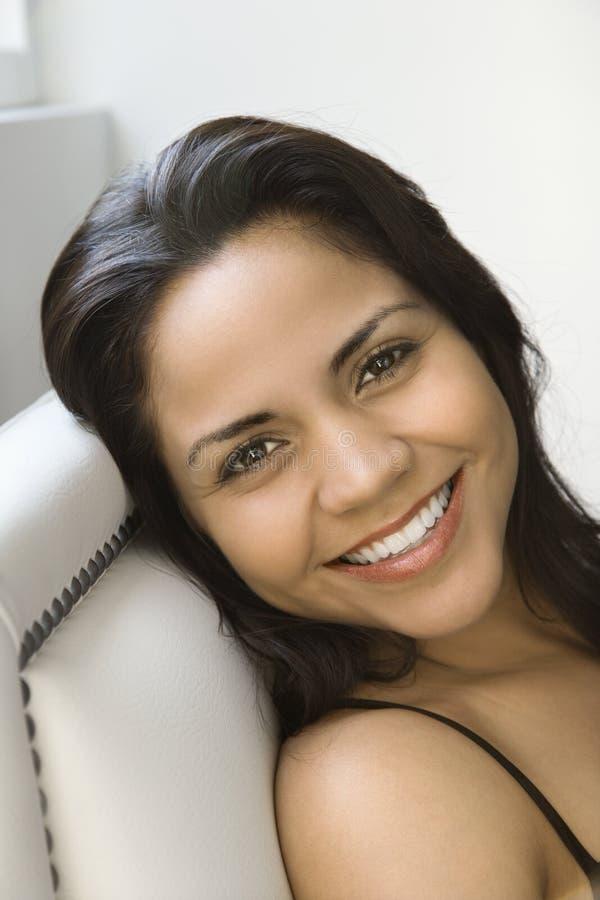 Hispanic woman portrait. Head shot of smiling Hispanic woman looking at viewer royalty free stock photos