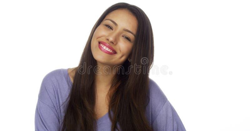 Hispanic woman smiling at camera stock photography