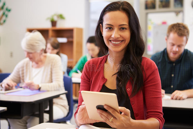 Hispanic woman with tablet computer at an adult education class stock images