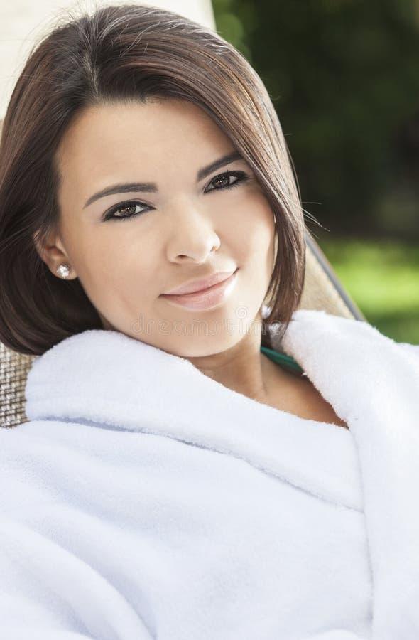 Hispanic Woman in White Robe At Health Spa stock photos