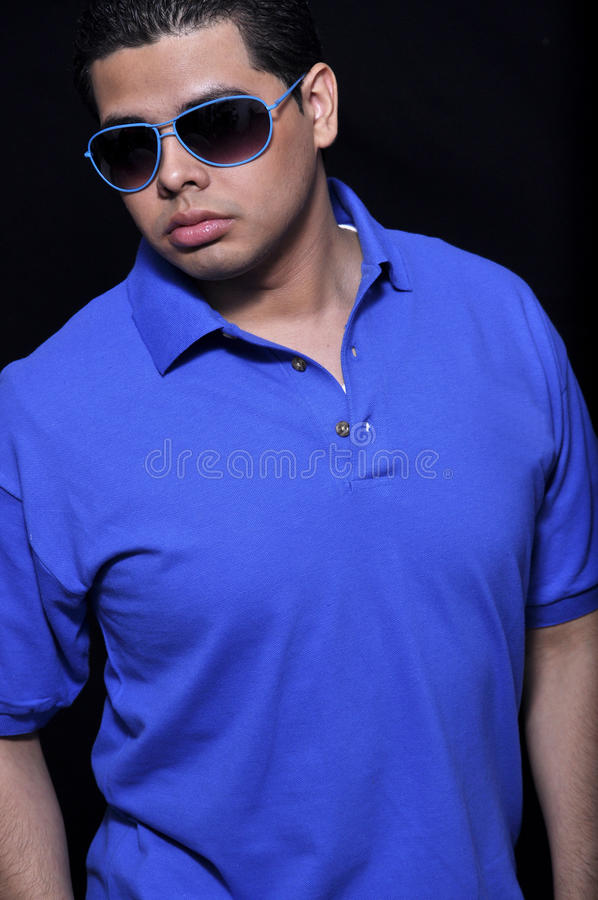 Hispanic young man. This picture represents a Hispanic young man wearing sunglasses royalty free stock photography