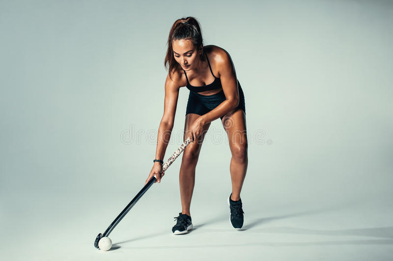 Hispanic young woman playing hockey royalty free stock images