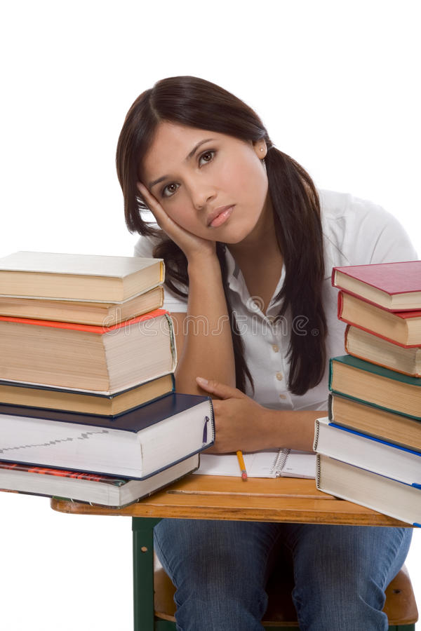 Hispanische Studentfrau mit Stapel Büchern lizenzfreie stockfotos