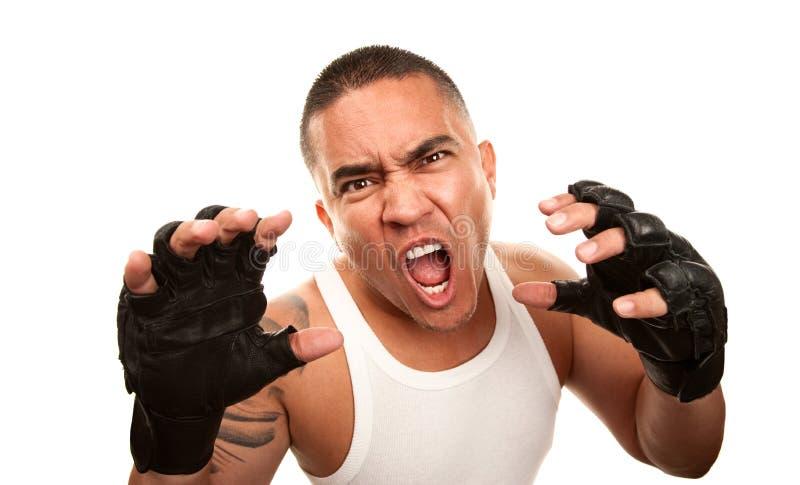 Hispanischer Mann mit Verpacken-Handschuhen lizenzfreie stockfotos