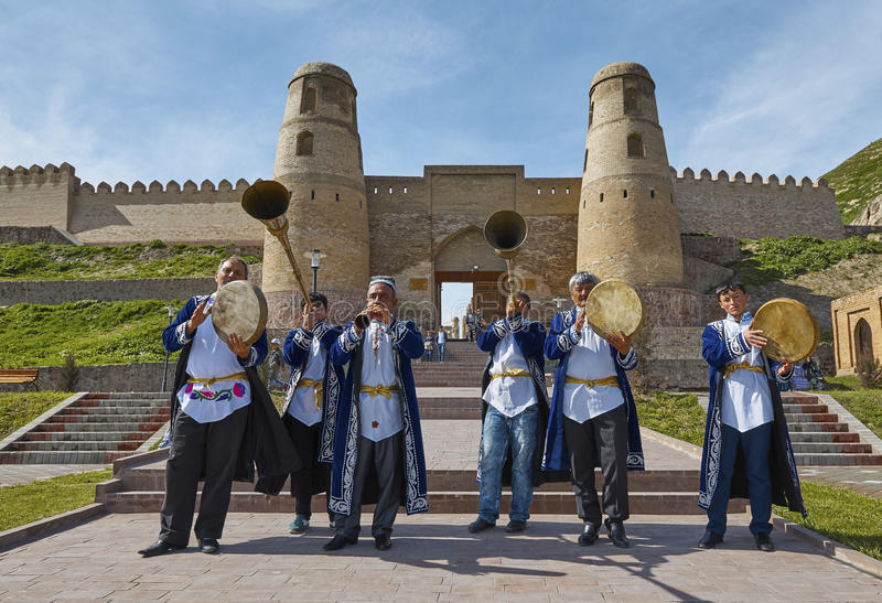 HISSAR,TAJIKISTAN-MARCH 15,2016: The musicians in national costumes welcome guests to Hissar fortress royalty free stock photography