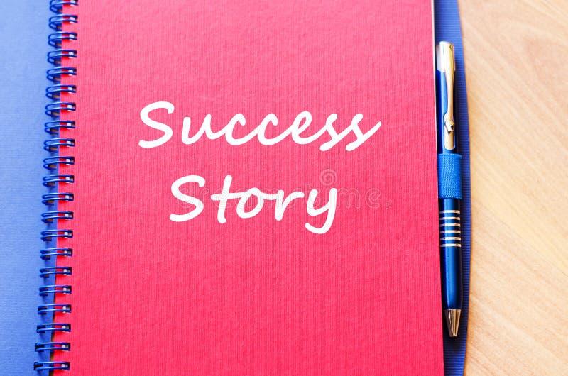 A história de sucesso escreve no caderno imagens de stock