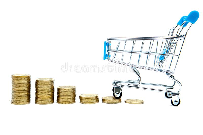Histogram of coins and shopping cart or supermarket trolley on a white background, business finance shopping concept stock image