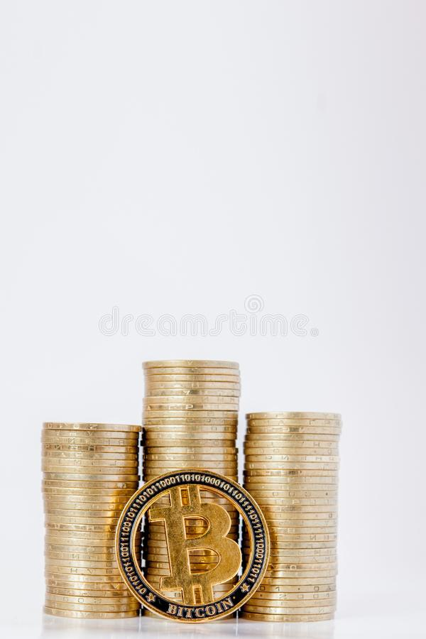 Histograma of coins and bitcoin on the white background. Concept of currency growth, savings.  royalty free stock image