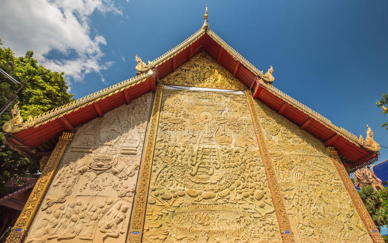 Historia del budista del estuco de la pared fotos de archivo