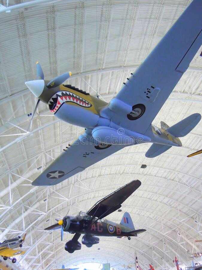 Historic aircraft suspended from museum ceiling. A Curtiss P-40 Warhawk and a Westland Lysander aircraft in the Air & Space Museum in Washington DC in the United stock photo