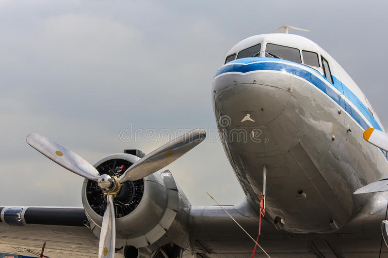 Historic airliner. A classic Dakota aircraft, with cockpit and right engine in view royalty free stock image