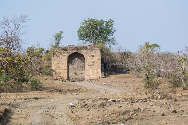 Historic Ancient Gate of Sultanate Era in India. Historic 14th Century Ancient Gate of Malwa Sultanate Era in forest of Mohada Ghat near Indore Madhya Pradesh royalty free stock photo