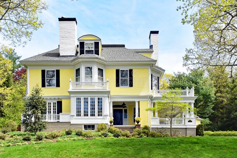 Historic Architecture in New England. Historic house or home in Massachusetts, New England. White and yellow exterior. Spring. Front yard view royalty free stock photography