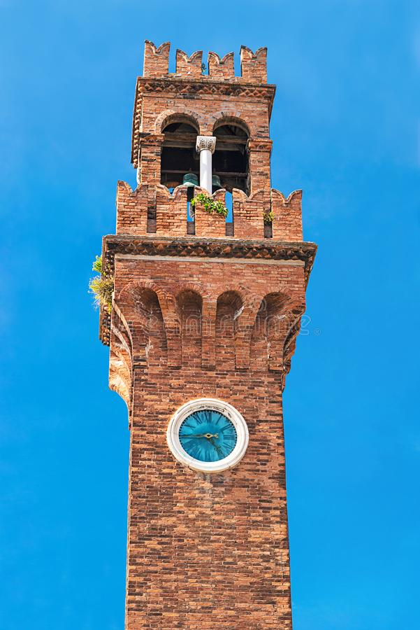 Historic architecture San Stefano Church Bell Tower with clock in Murano island, famous by glass making, Italy, Venice, against stock image