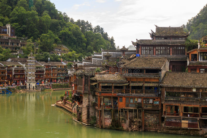 Historic Asian Village. Wooden Houses Above the Water. Trasitional Chinese Architecture Wood Buildings. Photo of Historic Asian Village. Wooden Houses Above the stock images