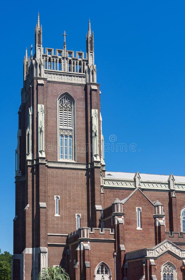 Historic Bell Tower and Church in New Orleans. Historic church and bell tower exterior of neo-gothic architecture in new orleans louisiana stock photography