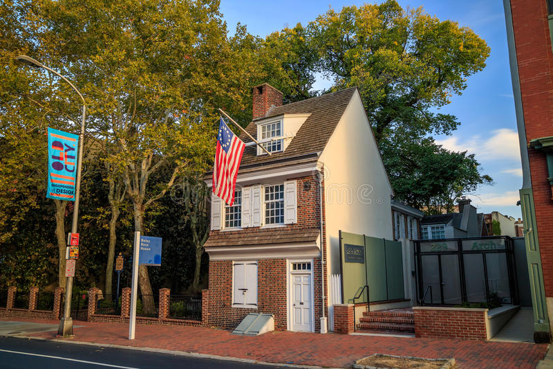 The historic Betsy Ross house. PHILADELPHIA - OCT 19: The historic Betsy Ross house tourism landmark with hanging American flag in Old City Philadelphia on stock photography
