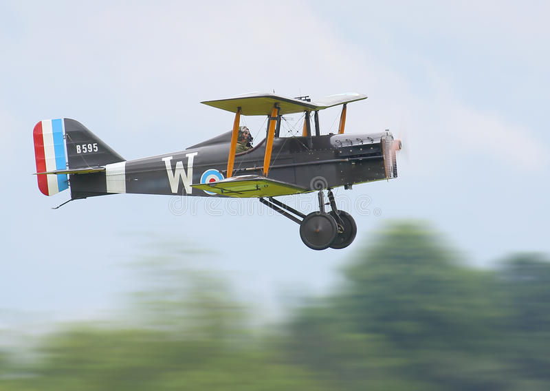 Historic biplane in flight. Historic world war one British biplane fighter plane, Royal Aircraft Factory SE5 in flight. Cosford airbase, June 7th 2014 stock images