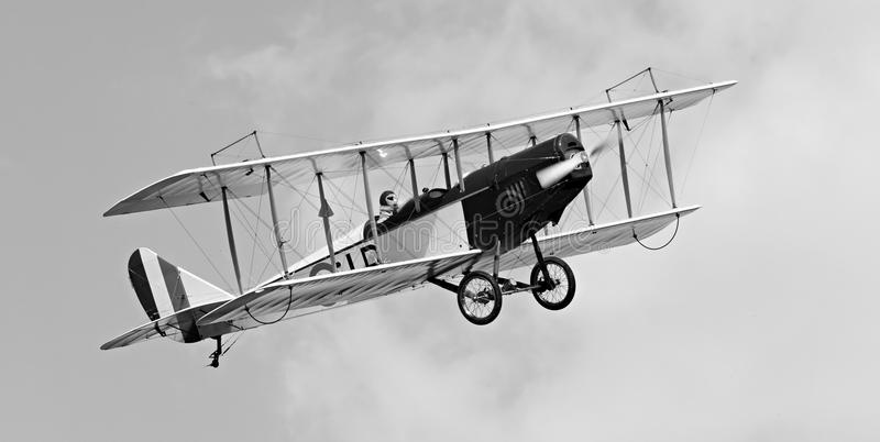 Historic biplane on the sky. Historic biplane on the sky - vintage style photography - Homemade radio control aircraft with electric motor royalty free stock photo