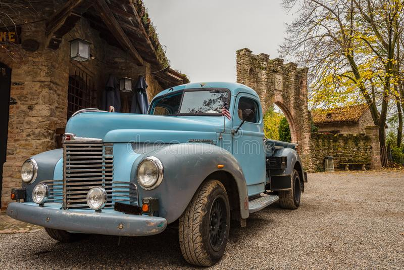 Historic blue-colored pickup parked in the streets stock photography