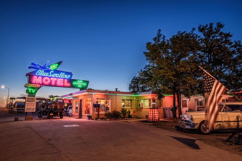 Historic Blue Swallow Motel in Tucumcari, New Mexico. TUCUMCARI, NEW MEXICO - MAY 13, 2016 : Historic Blue Swallow Motel with vintage cars parked in front of it stock photos