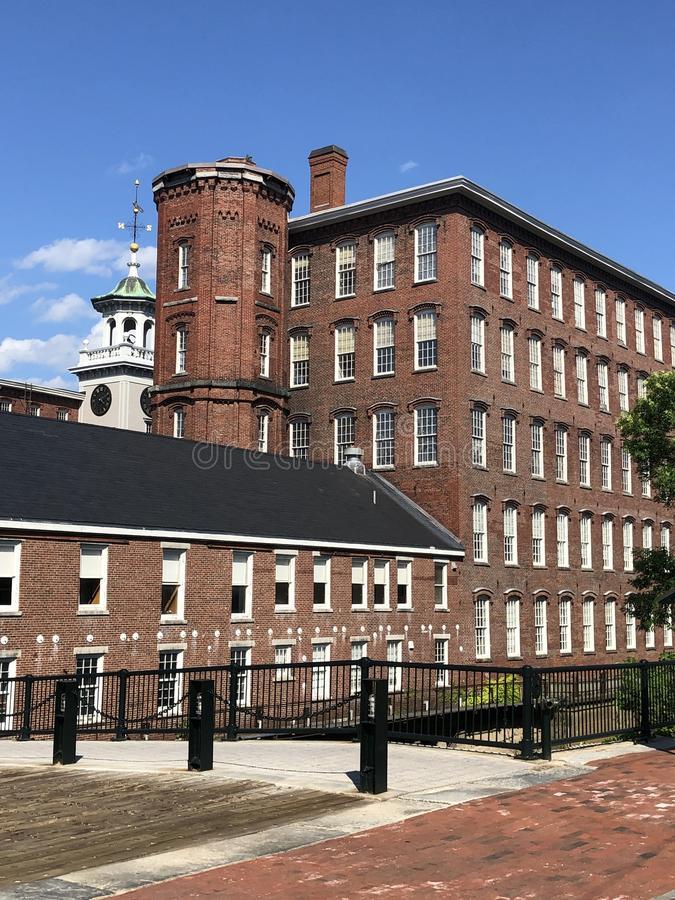 Historic Boott Mills, Lowell Massachusetts. Historic Boott Cotton Textile Mills along the Merrimack River in industrial Lowell, Massachusetts, now part of the royalty free stock photo