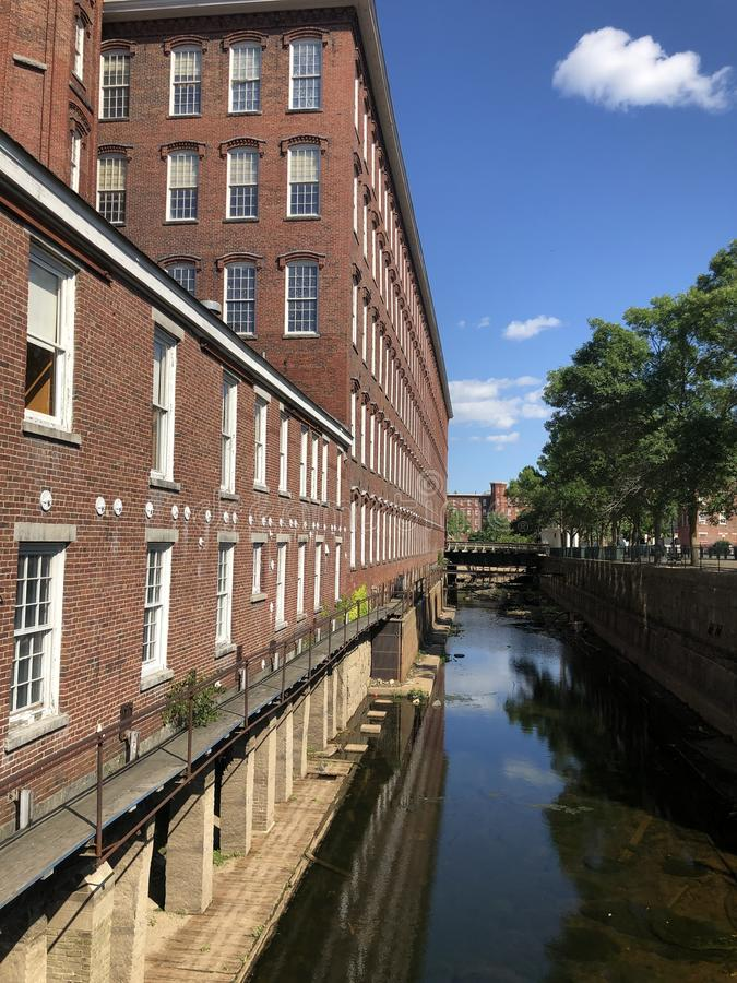 Historic Boott Mills, Lowell Massachusetts. Historic Boott Cotton Textile Mills along the Merrimack River in industrial Lowell, Massachusetts, now part of the stock images