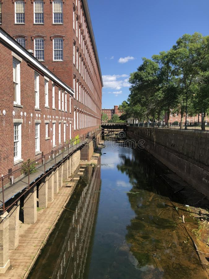 Historic Boott Mills, Lowell Massachusetts. Historic Boott Cotton Textile Mills along the Merrimack River in industrial Lowell, Massachusetts, now part of the royalty free stock images