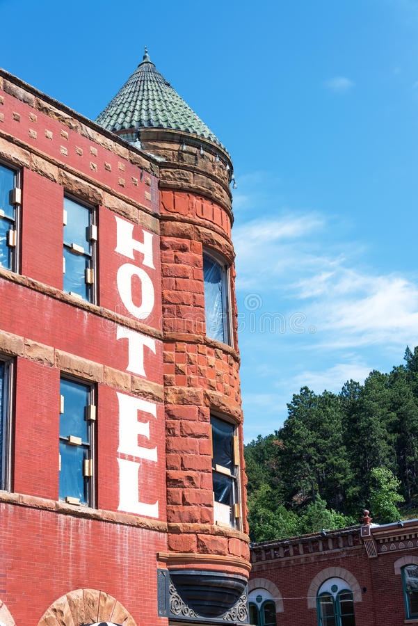 Historic Brick Building in Deadwood, South Dakota. View of historic hotel in the old west town of Deadwood, South Dakota royalty free stock image