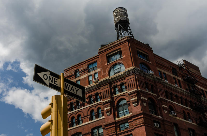 Download Historic Brick Building In New York City With Water Tower On Top Stoplight
