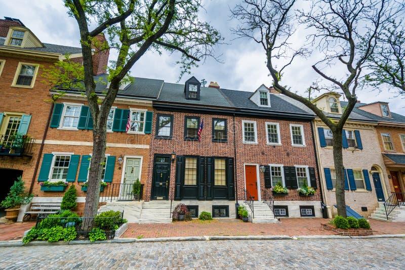 Historic brick row houses on a cobblestone street in Society Hill, Philadelphia, Pennsylvania royalty free stock images